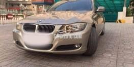Cần bán BMW 3 Series 320i đời 2010, màu vàng cát.