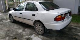 Cần bán xe ô tô Mazda 323F màu trắng