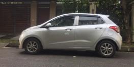 Gia đình cần bán chiếc xe ô tô Hyundai Grand i10 màu bạc