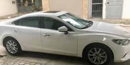 Bán xe Mazda 6 2.0 đời 2016, màu trắng, giá: 690 triệu.