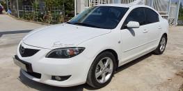 Cần bán xe Mazda 3 1.6 số sàn năm 2007, màu trắng, đã đi 120.000km